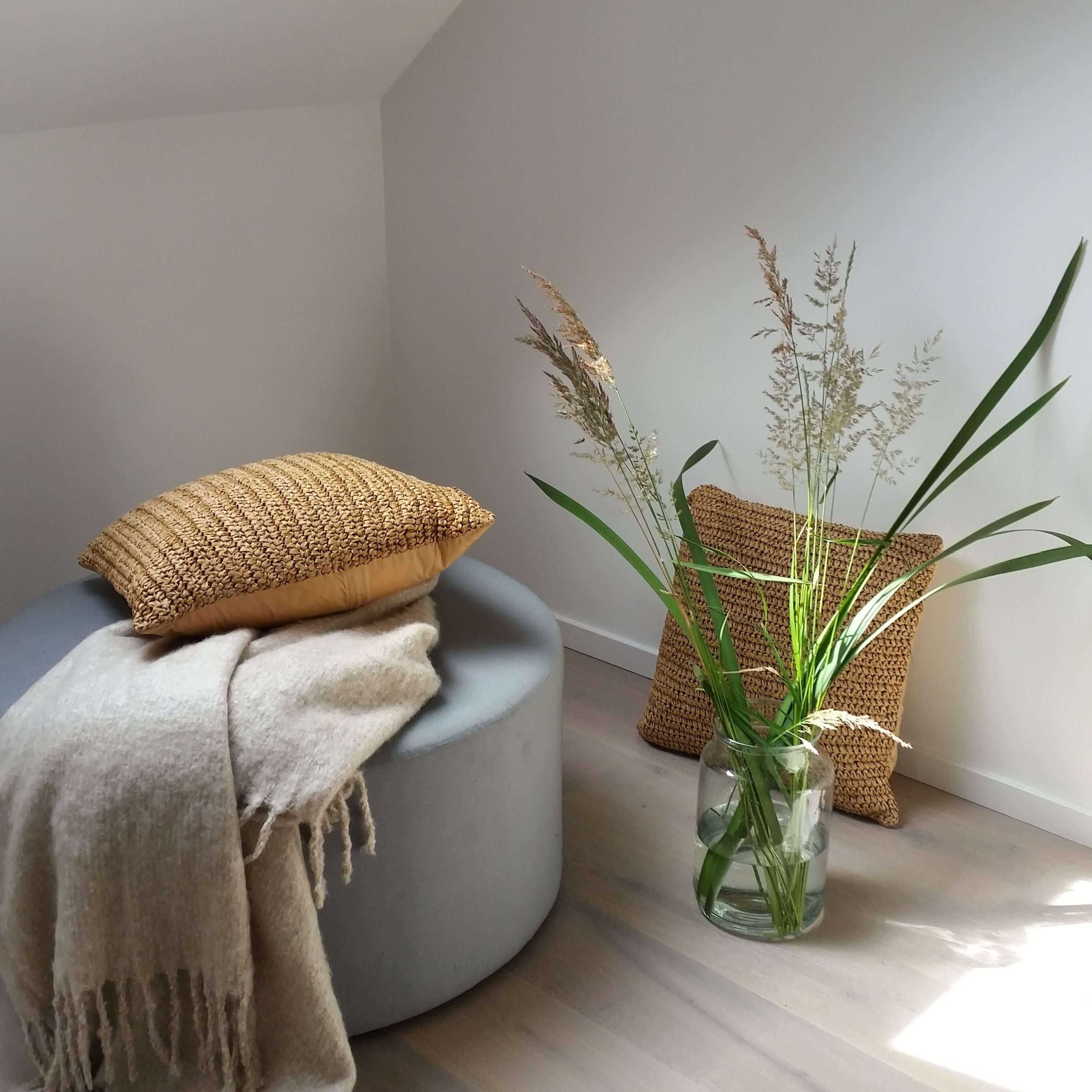 att inreda med växter eller gräs i vas
