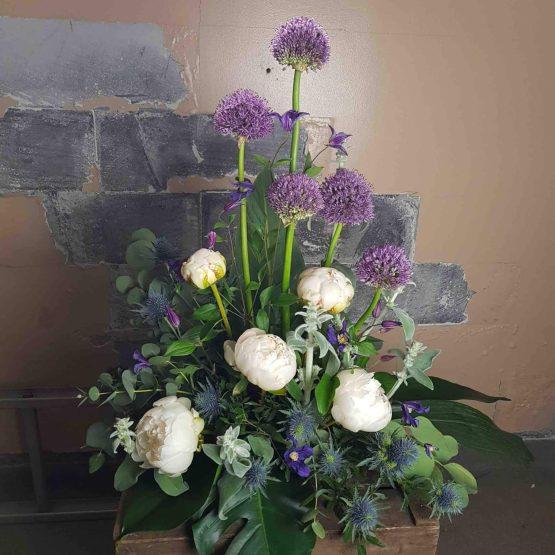 begravningsdekoration lila